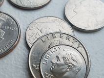 US coin currency in closeup Liberty dime and quarters royalty free stock images