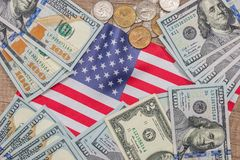 Us coin and dollar banknote. With usa flag stock images