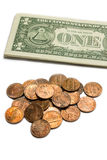 Us coins and dollar bills. Stock Photos