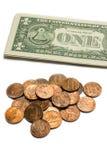 Us coins and dollar bills. Stock Photos