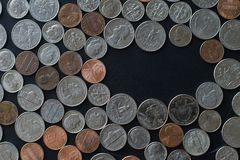 US coins on flat surface with void space for text. And your own message Royalty Free Stock Images