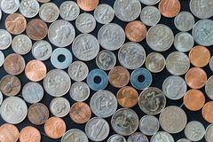 US coins on flat surface with washers. On table stock images