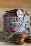 US coins in metal box. US one cent coins overflow from metal box Royalty Free Stock Image