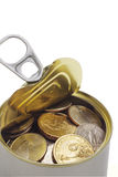 US coins in open tin can Stock Photo