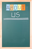 About us, colorful word on blackboard Stock Photos