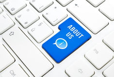 About Us concept, blue enter button or key on white keyboard Royalty Free Stock Photo