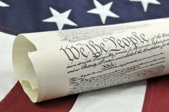 US Constitution. And American flag background Stock Photography