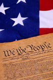US Constitution. Preamble to the US Constitution with the stars and stripes in the background Stock Photo