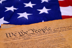 US Constitution. Preamble to the US Constitution with the stars and stripes in the background Royalty Free Stock Photo