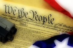 US Constitution with Hand Gun - Right To Keep and Bear Arms. US Constitution Bill of Rights with hand gun - History of the Second Amendment Royalty Free Stock Photos
