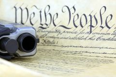 US Constitution with Hand Gun Stock Photos