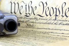 US Constitution with Hand Gun Stock Image