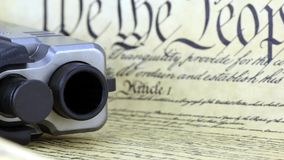US Constitution with Hand Gun - Right To Keep and Bear Arms. US Constitution Bill of Rights with hand gun - History of the Second Amendment stock footage