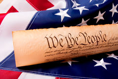 US Constitution - We The People. Old fashionet American Constitution with USA  Flag Royalty Free Stock Photography