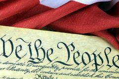 US Constitution - We The People with American Flag Stock Image