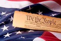 US Constitution - We The People   with USA  Flag. Old fashionet American Constitution with USA  Flag Stock Photo