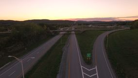 US Countryside Aerial. V2 Flying low over Vermont 279 and Highway 7 interchange towards Bennington at sunset stock video