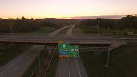 US Countryside Aerial. V1 Flying low over Vermont 279 towards Bennington VT at sunset stock video footage