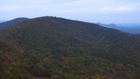 US Countryside Aerial. V12 Flying over autumn rolling hills panning near Helen GA stock video footage