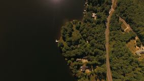 US Countryside Aerial. V7 Flying over Franklin Pierce Lake and lake homes looking down vertically stock footage