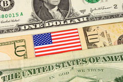 US Currency. A closeup of American currency bank notes and Stars & Stripes flag Royalty Free Stock Photo