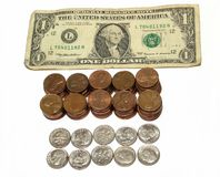 US Currency. Closeup one dollar bill 100 pennies and 10 dimes on white background Royalty Free Stock Photo