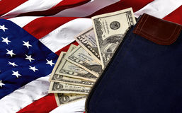 US Currency on American Flag in a Money Bag Stock Photo