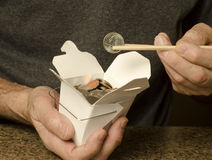 US currency in Chinese food container Stock Photo