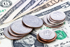 US currency coins and notes. US coins sitting on five ten and fifty dollar notes stock images
