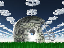 US Currency Helmet on Grass Royalty Free Stock Image