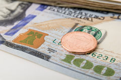 US Currency with one dollar coins. Sitting on one hundred dollar note Royalty Free Stock Images