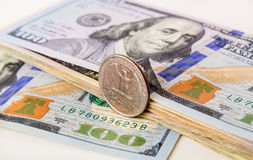 US Currency with one quarter coin Stock Image
