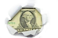US currency peeking through white paper. Stock Photos