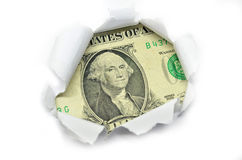 US currency peeking through white paper. Royalty Free Stock Images