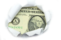 US currency peeking through white paper. Stock Photo