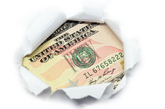 US currency peeking through white paper. Stock Images