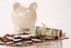 US currency and piggy bank Royalty Free Stock Photos