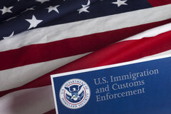 US Customs and Border Enforcement. And USA flag stock photography