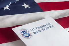 US Customs and Border Protection. With flag royalty free stock images