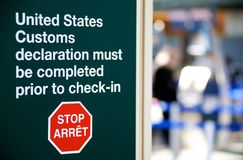 US Customs warning. A warning to complete US Customs declaration at an airport Royalty Free Stock Photography
