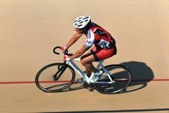 US Cycling Pro event. Cyclist race along the banked oval track at the professional Velodrone bicycle race track, USA Cycling event, Ohio, USA Royalty Free Stock Photography