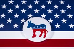 The US Democrat Party. LONDON, UK - DECEMBER 18TH 2017: The Donkey symbol of the Democrat Party, with the American flag behind it, on 18th December 2017 Royalty Free Stock Photos