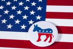 The US Democrat Party. LONDON, UK - DECEMBER 18TH 2017: The Donkey symbol of the Democrat Party, with the American flag behind it, on 18th December 2017 Stock Image