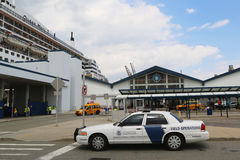 US Department of Homeland Security US Customs and Border Protection providing security for Queen Mary 2 cruise ship. NEW YORK CITY - JULY 1: US Department of Royalty Free Stock Images