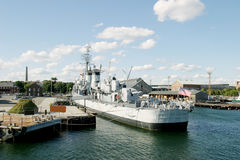 US Destroyer. A US Destroyer docked in Boston, with bunker hill in the background Royalty Free Stock Photography
