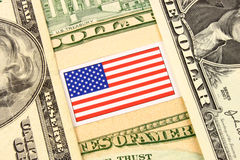 US Dollar. A closeup of American currency bank notes and Stars & Stripes flag Stock Photos