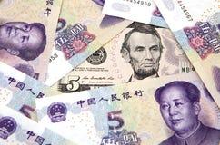US dollar against china yuan Stock Photo
