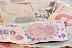 US dollar and Argentine peso bills Royalty Free Stock Photography