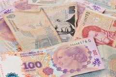 US dollar and Argentine peso bills Stock Image