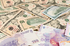 US dollar and Argentine peso bills Royalty Free Stock Photos